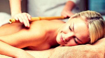 Woman Receiving A Warm Bamboo Massage